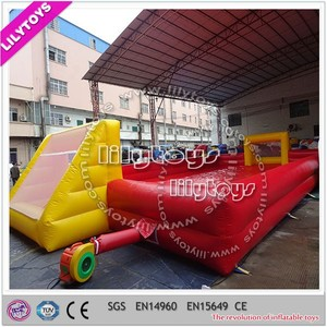 Particular design red portable inflatable football field 0.55mm plato pvc customized outdoor game inflatable soap football field