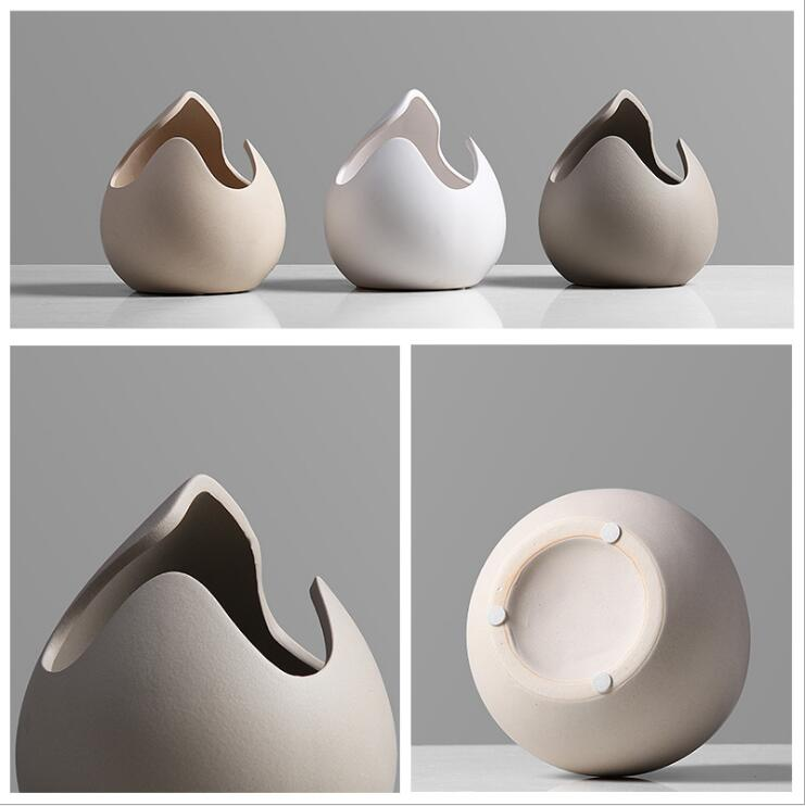 Simple and creative ceramic floral decoration on the living room mesa, eggshell and small flower bottle decoration