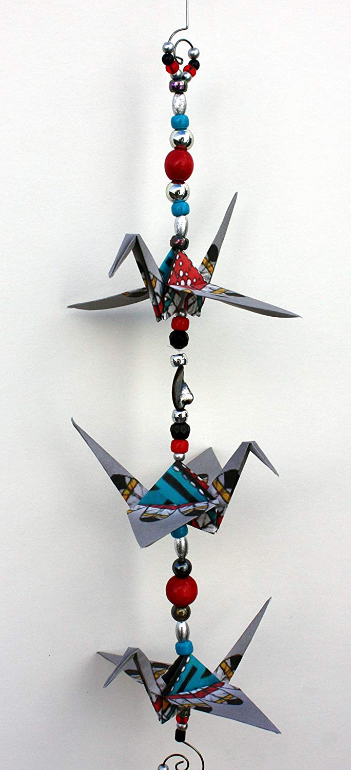 """Good Luck"" Southwestern Feather and Face design crane mobile for indoor decor. approx. 17"" high and 5.5"" wide. A unique handmade origami accent piece."