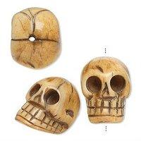 Antiqued bone 20x14mm hand-carved skull beads