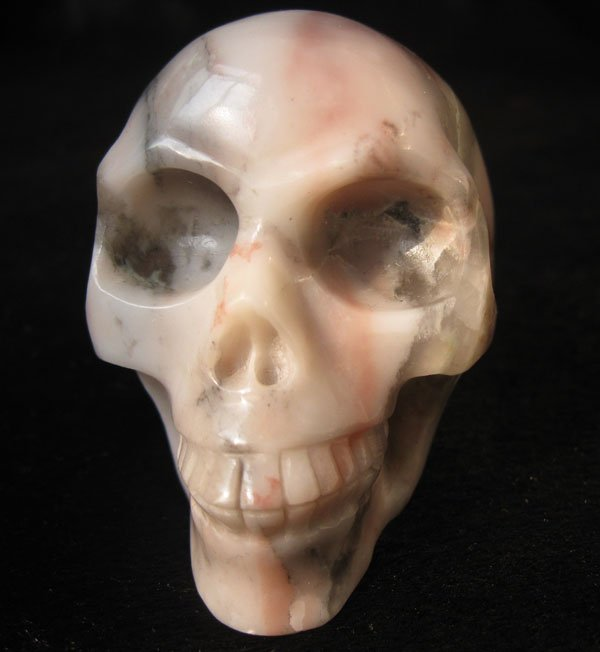 Natural cherry stone skull carving