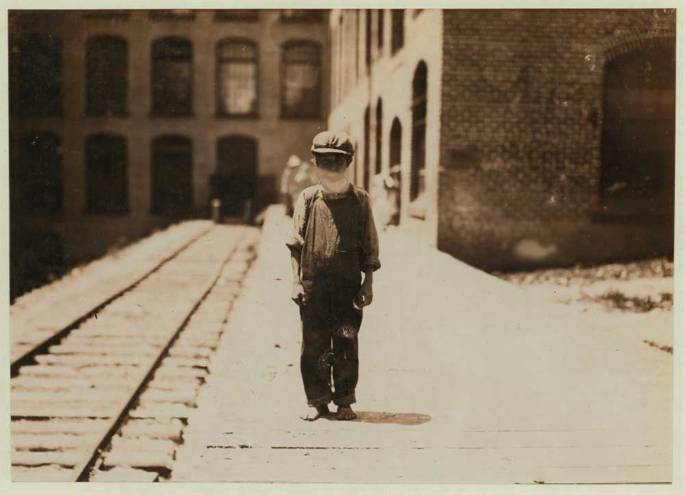 1911 Photo One of the young doffers in Washington Cotton Mills, Fries, Va., going to dinner. Said he was 15 years old, but it is doubtful. Location: Fries, Virginia. Location: Fries, Virginia