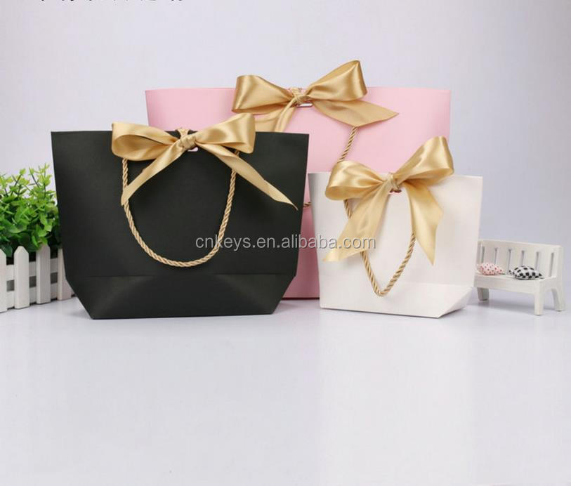 E0952A Custom clothing bag gift cosmetics portable paper shopping bag packaging paper bag printed LOGO