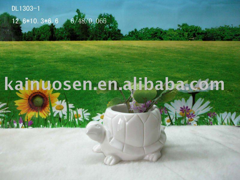ceramic flower pot with turtle design