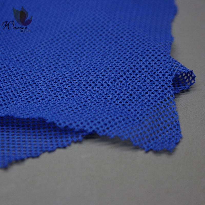 Hot Sales Hollow DTY Hardshell Interlining Fabric 75D Warp Knitted Four Angle Mesh Fabric For Garment Lining