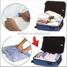 hand squeezing travel clothes compression bag