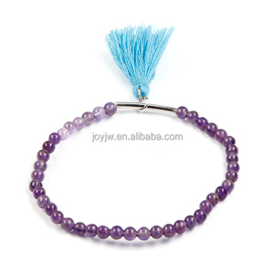 Cheap crystal natural stone bracelet popular jewelry with metal accessories,cotton tassel