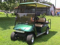 2005 ez go golf cart 4 seater with flatbed green with tan seats. great condition!