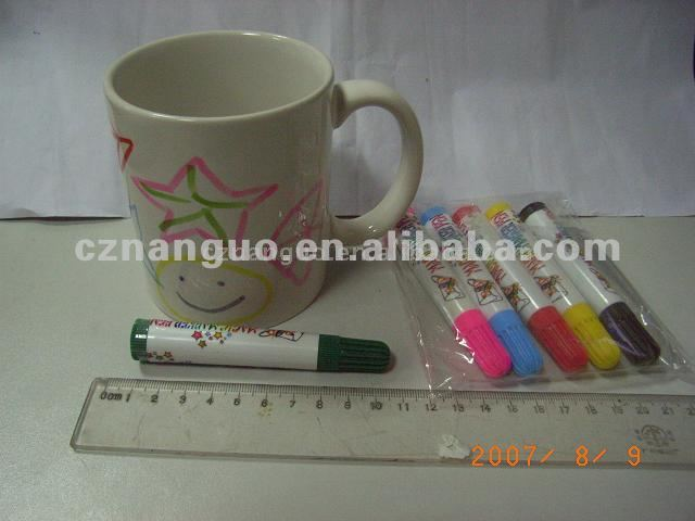 Paint your ceramic mug with magic marker or pen