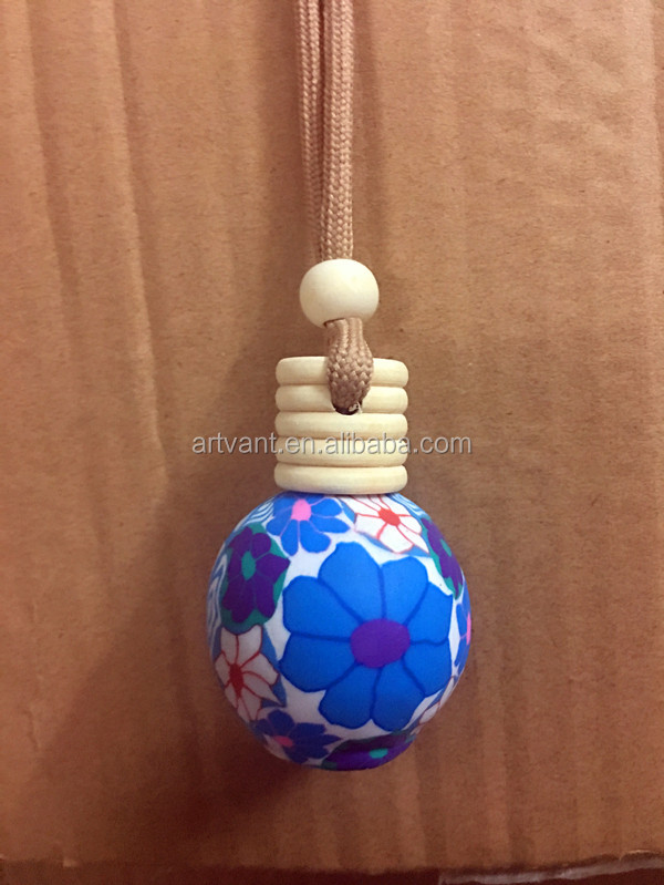 Hot Selling Type Diffuser Hanging Car perfume Bottle Round shape Polymer Material Empty Bottle with wooden Cap