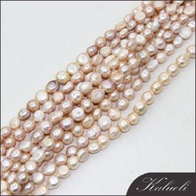 In bulk sale cheap 13-15 mm peach freshwater pearl baroque