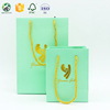 /product-detail/customized-metallic-gold-foil-paper-gift-bag-paper-shopping-bag-with-your-logo-60687139772.html