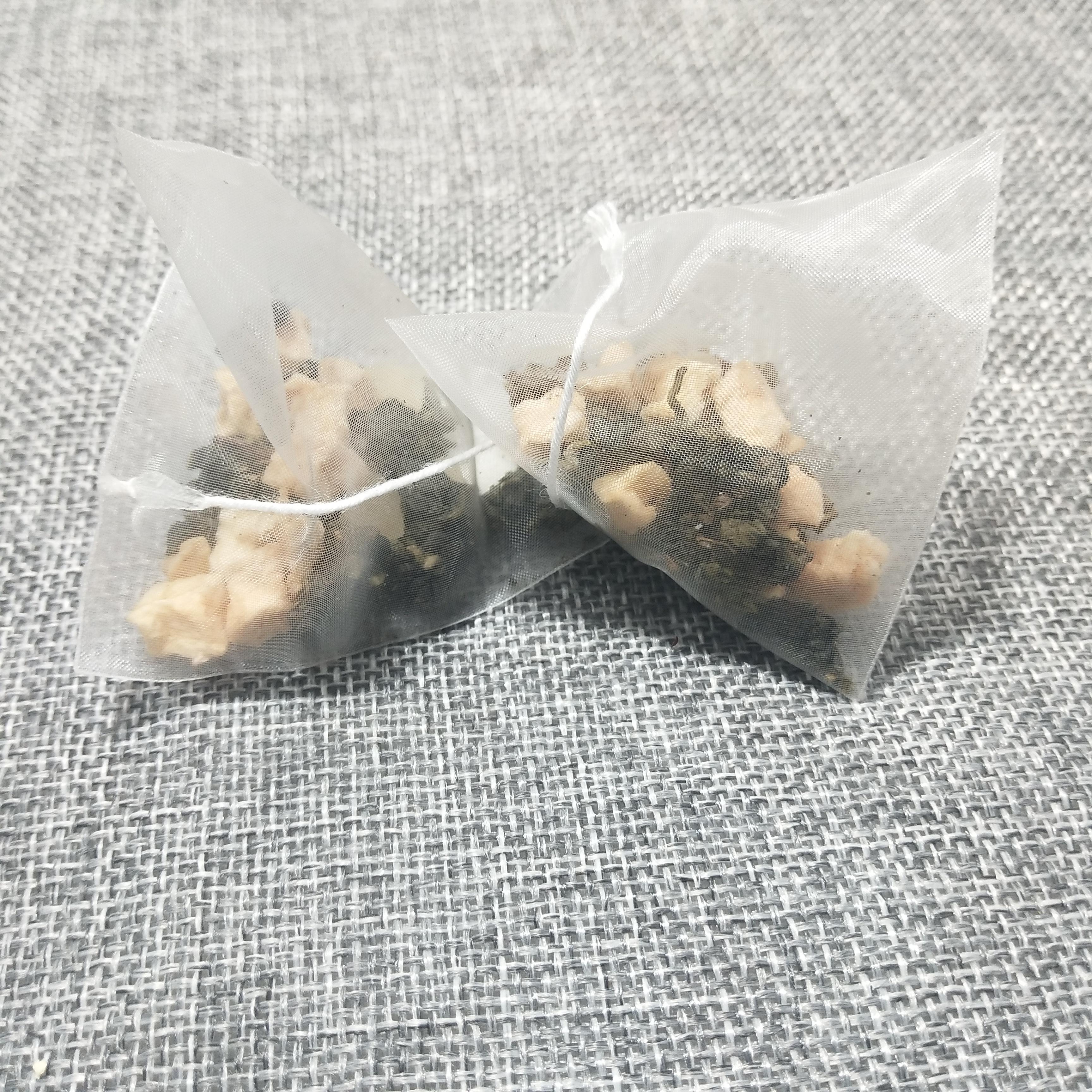 T152 Wholesale Nylon Pyramid Tea Bags Peach Oolong Tea - 4uTea | 4uTea.com