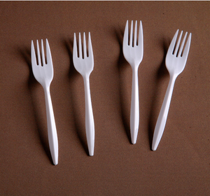 medium white disposable plastic fork