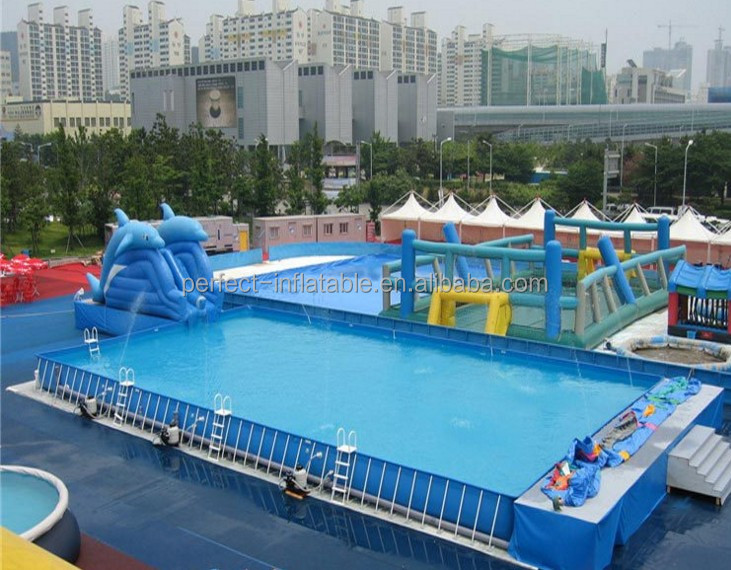 Large inflatable swimming pool with holders and a lovely dolphin slide