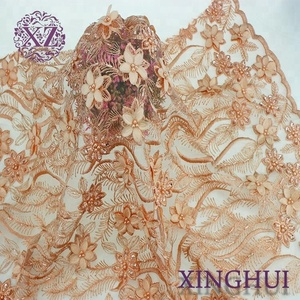 China orange polyester embroidered tulle african lace fabric