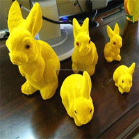 Top sale yellow resin rabbit flocked easter bunny