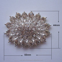Oval shaped modern silver brooch with clear crystal stones + clip at the back