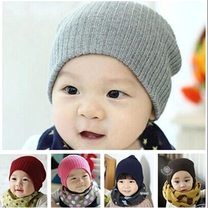 9718c690b Fashion spring winter warm cute baby knitted beanie pom pom hats Skullies for  boys and girls