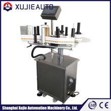 automatic round bottle labeling head with connected packaging machine