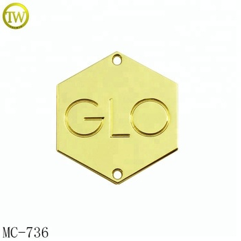 Custom made gold metal clothing logos 2 holes metal label tag for swimwear