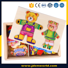Two bears change clothes and face wooden toy for 1 year old children