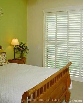White Door Plantation Shutters With Hidden Tilt Rod Bedroom