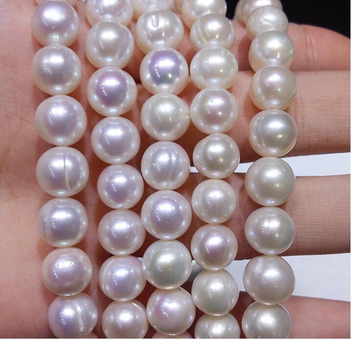 9-10mm loose strong gloss slightly flawed circled round white pearl in 39cm strand