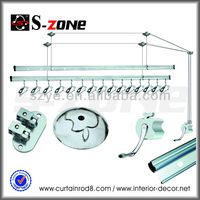 Laundry room hand control lifting wall mounted clothes hanger racks