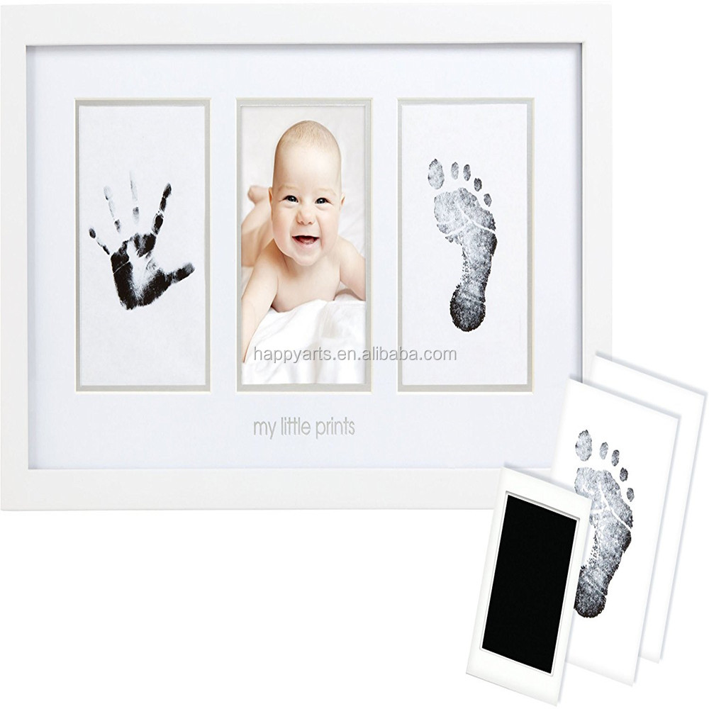 newborn baby handprint and footprint photo frame kit with an