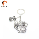 Promotional Gifts Small Irregular Stamping Stainless Steel Souvenir Keyring 3D Casting Key Chain Rings Metal Logo Customized