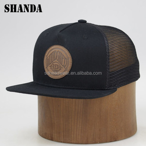 d2f1445d0 Wholesale design your logo flat bill cotton embossed leather patch trucker  hat
