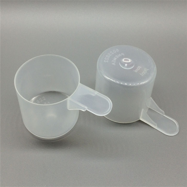 Hot sell short handle 70ml clear transparent plastic spoon /cup measuring protein powder scoops washing scoops manufactures