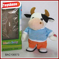 Plush toys dancing cow