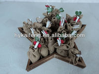 Wooden star with 24 jute bags