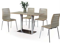 vogue rectangle wood cover metal legs dining table with four wood chair without armrest