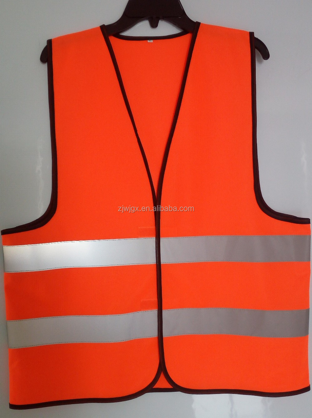 Orange safety coats conforms to EN ISO 20471