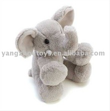 cute lovely little plush stuffed toy elephant in grey color in sitting