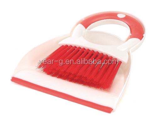 red soft bristle brush and dustpan for table cleaning