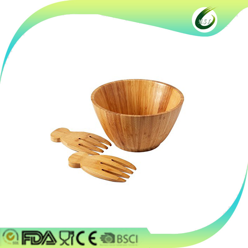 wooden bamboo salad bowls with serving hands and serving bowls