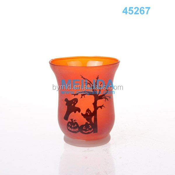 Bell shaped orange glass candle holder for Christmas day