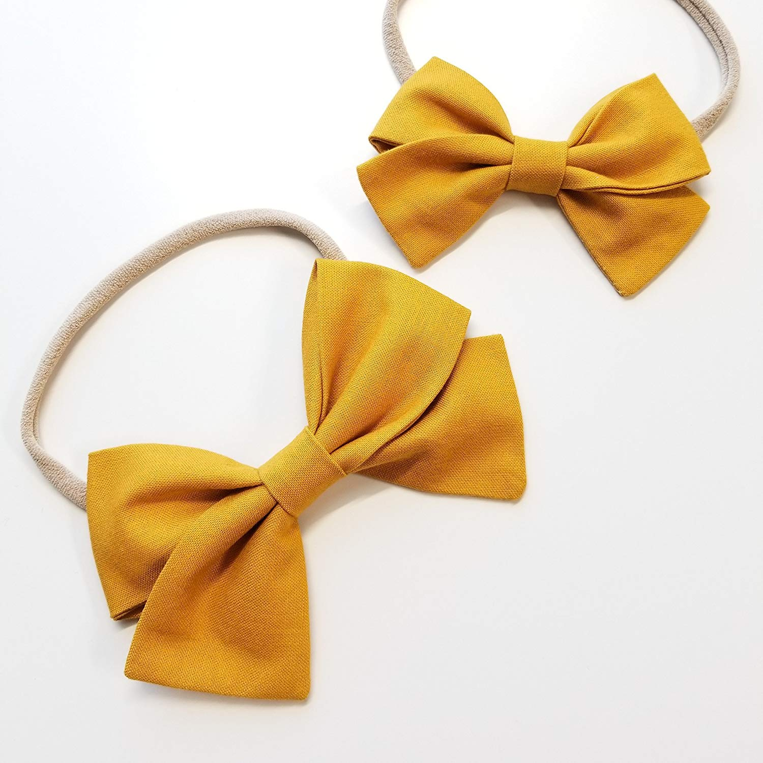 d03a0d49871b Get Quotations · Handmade Baby Girl Bow newborn headband baby bow Alligator  clip Solid Mustard Nylon Headband or Hair