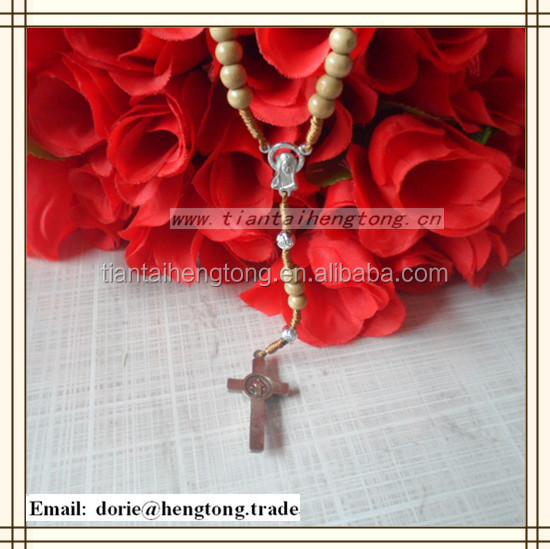Brown religious rosary bead necklace with crucified Jesus and Virgin Mary