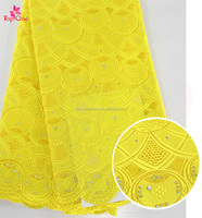 African dry lace newest lace design in 2017 yellow embroidery cotton lace with stones Nigeria bridal wedding material fabrics
