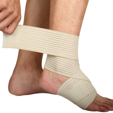 Professional wrapping an ankle for support with high quality