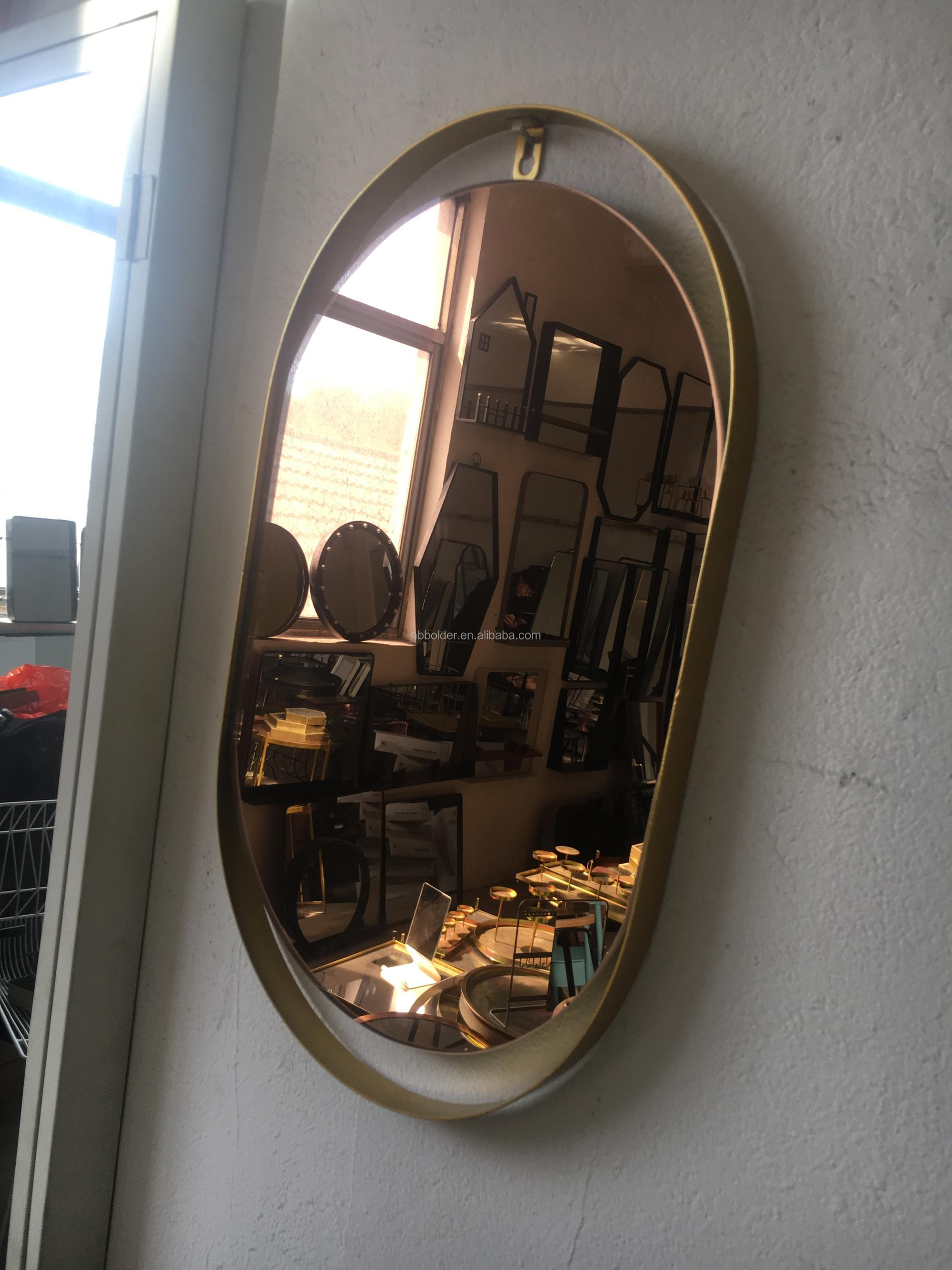 Decorative gold metal frame oval wall mirror with brown glass mirror