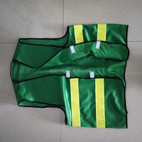 green reflective warning vest for airport