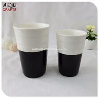 white and black glazed porcelain candle holder