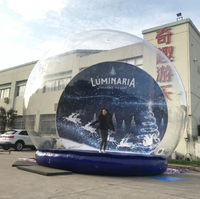 Family size inflatable snow globe with bouncer for events