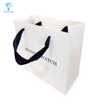 Customized fashion white portable with handle clothes shopping paper bag